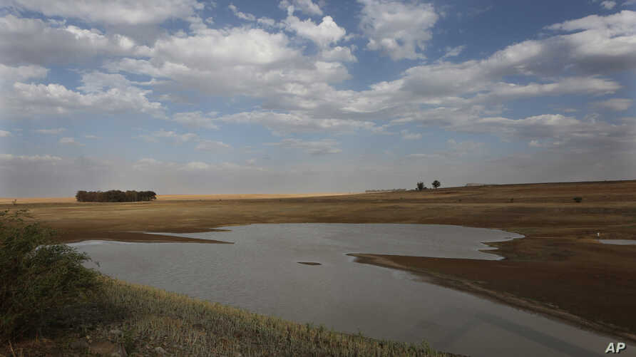 FILE - Taps and water sources have run dry in South Africa's almost dried-up local dam in Senekal, Jan. 7, 2016. Senekal, a small town in South Africa's rural Free State province, is  one of four regions declared disaster areas as a drought dries up