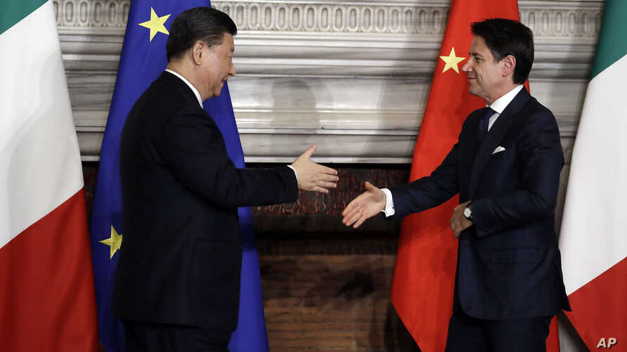 "Chinese President Xi Jinping, left, and Italian Prime Minister Giuseppe Conte shake their hands following the signing of a memorandum in support of Beijing's ""Belt and Road"" initiative, at Rome's Villa Madama, March 23, 2019."