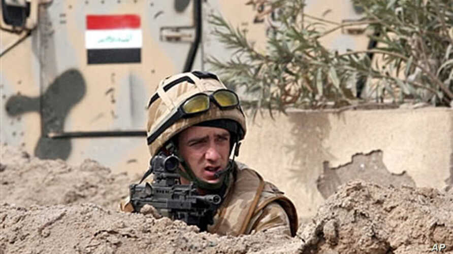 A British soldier takes position following a road side bomb which detonated as a British patrol rolled by in the southern city of Basra, Iraq (File)