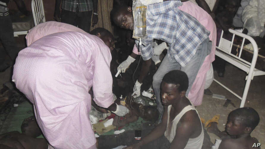 People injured in a suicide bomb attack are treated at the General hospital in Potiskum, Nigeria, Nov. 3, 2014.