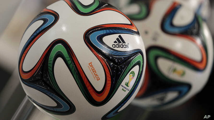 """The adidas logo is printed on """"Brazuca"""", the official FIFA World Cup 2014 soccer ball, during the annual shareholders meeting in Fuerth, Germany, May 8, 2014."""