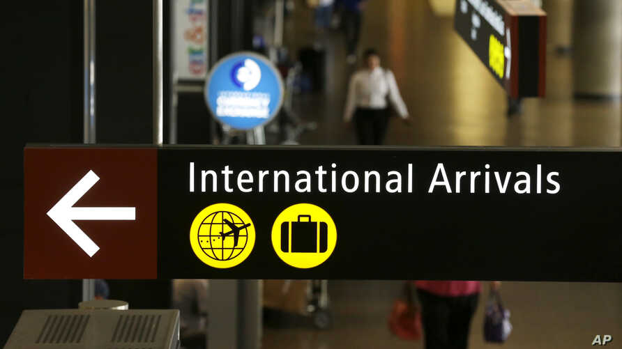 A sign for International Arrivals is shown at the Seattle-Tacoma International Airport in Seattle, June 26, 2017.