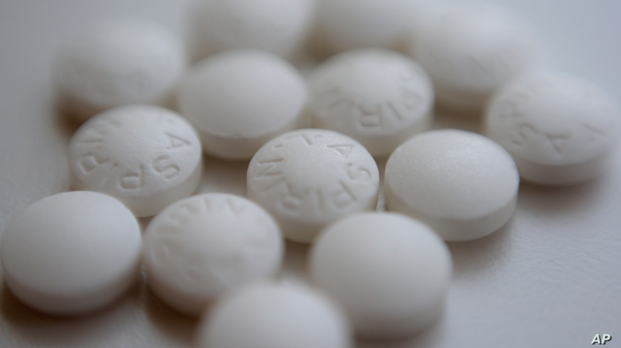 Aspirin pills are arranged on a counter in New York, Aug. 23, 2018. New studies find most people won't benefit from taking daily low-dose aspirin to prevent a first heart attack or stroke.