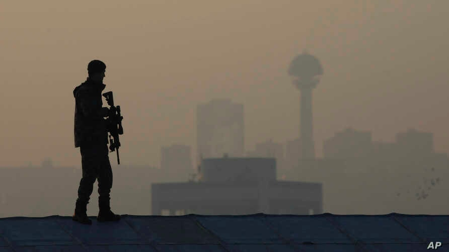 FILE -  A Turkish military special forces officer stands guard near the mausoleum of Mustafa Kemal Ataturk, the founder of modern-day Turkey in Ankara, Turkey, Nov. 10, 2017.