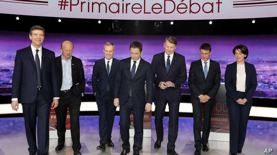 French politicians, from left to right, Arnaud Montebourg, Jean-Luc Bennahmias, Francois de Rugy, Benoit Hamon, Vincent Peillon, Manuel Valls and Sylvia Pinel, attend the first prime-time televised debate for the French left's presidential primaries