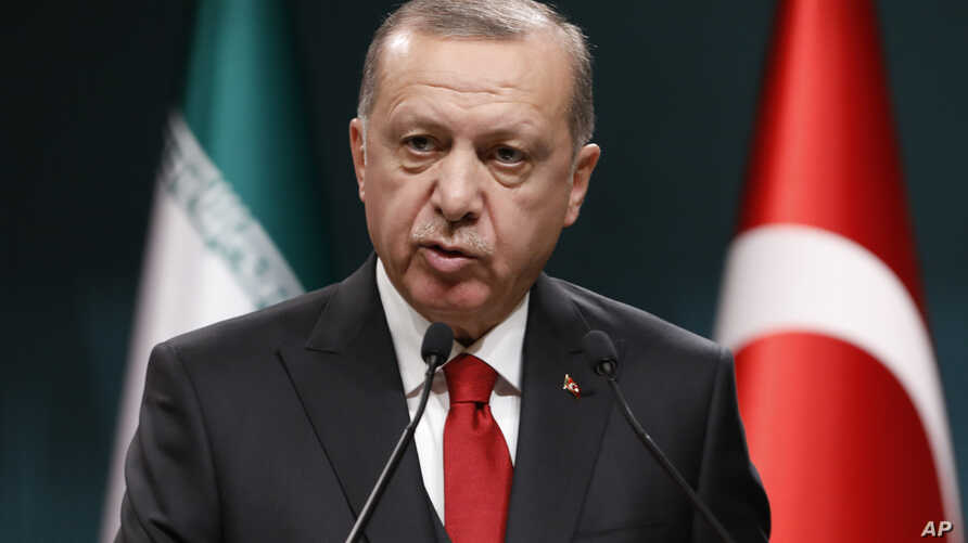 Turkey's President Recep Tayyip Erdogan talks during a news conference at the Presidential Palace in Ankara, Dec. 20, 2018.
