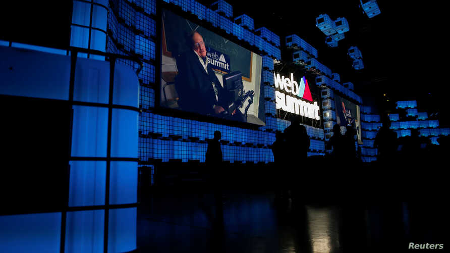 Cosmologist Stephen Hawking delivers a video message during the inauguration of Web Summit, Europe's biggest tech conference, in Lisbon, Portugal, Nov. 6, 2017.