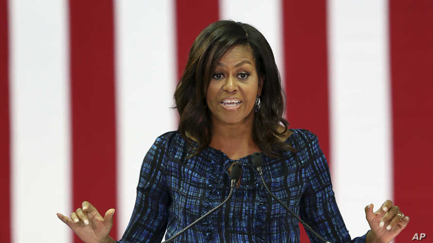 FILE - First lady Michelle Obama speaks at LaSalle University in Philadelphia, Sept. 28, 2016, as she campaigns for presidential candidate Hillary Clinton.