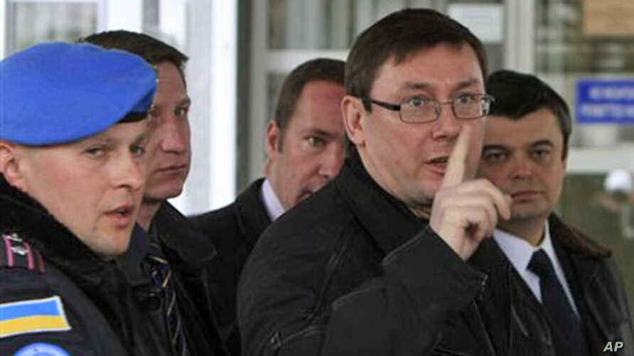 Yury Lutsenko, pointing finger, in a 2008 file photo, while he was Ukraine's interior minister