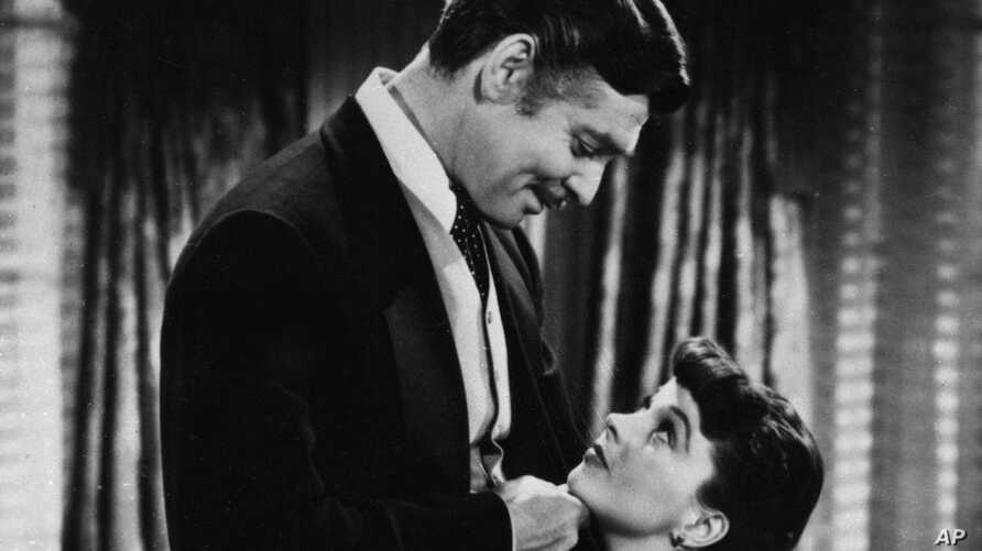 """Clark Gable, as Rhett Butler and Vivien Leigh as Scarlett O'Hara stars in the 1939 classic, """"Gone With the Wind""""."""