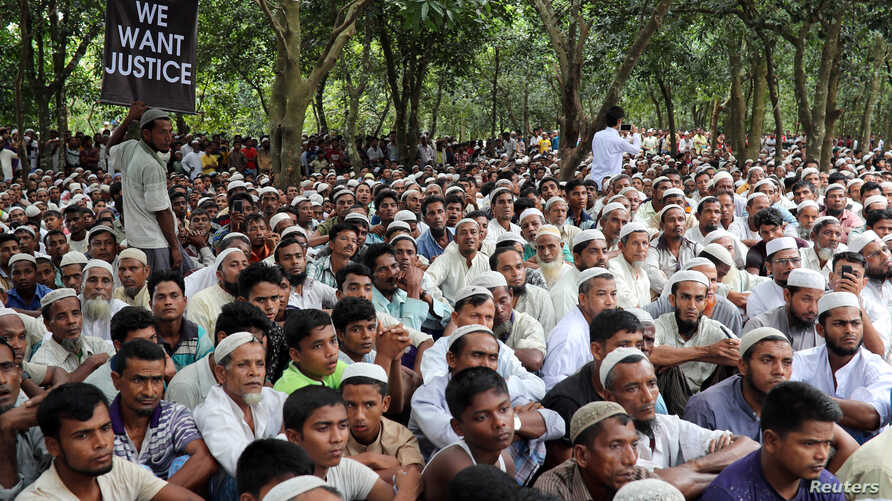 Rohingya refugees take part in a protest at the Kutupalong refugee camp to mark the one-year anniversary of their exodus from Myanmar, in Cox's Bazar, Bangladesh, Aug. 25, 2018.