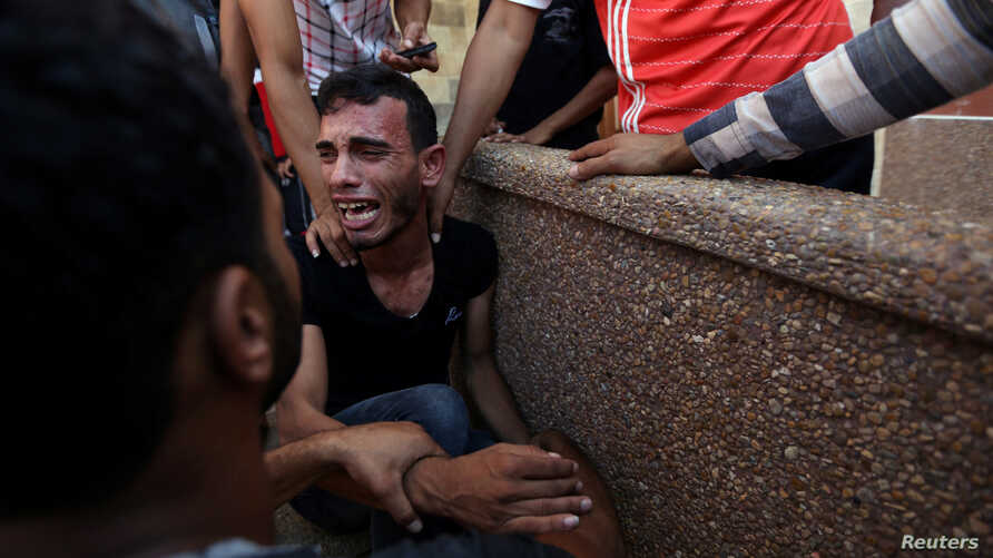 A relative of Palestinians who were killed at the Israel-Gaza border reacts in the southern Gaza Strip, Sept. 18, 2018.