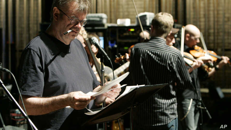"""Garrison Keillor looks over the script during rehearsal for """"A Prairie Home Companion"""" at the Fitzgerald Theater in St. Paul, Minn., April 13, 2007. (AP/file)"""