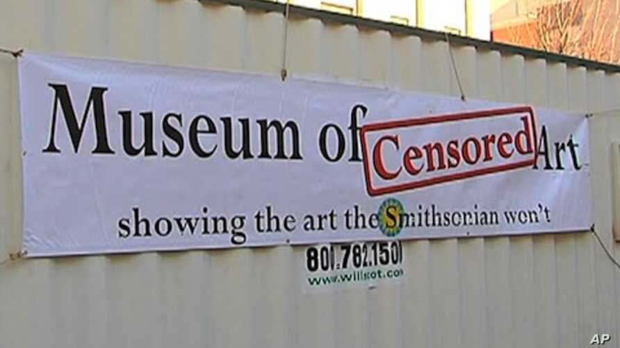 """Michael Iacovone recently he built a whole museum - inside a shipping container called the Museum of Censored Art. It is """"parked"""" in front of the Smithsonian Institution's National Portrait Gallery."""