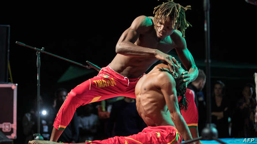 Members of Tinafan, an Guinean circus performing group, perform during the second edition of the African Circus Arts Festival in Addis Ababa, on March 2, 2018.