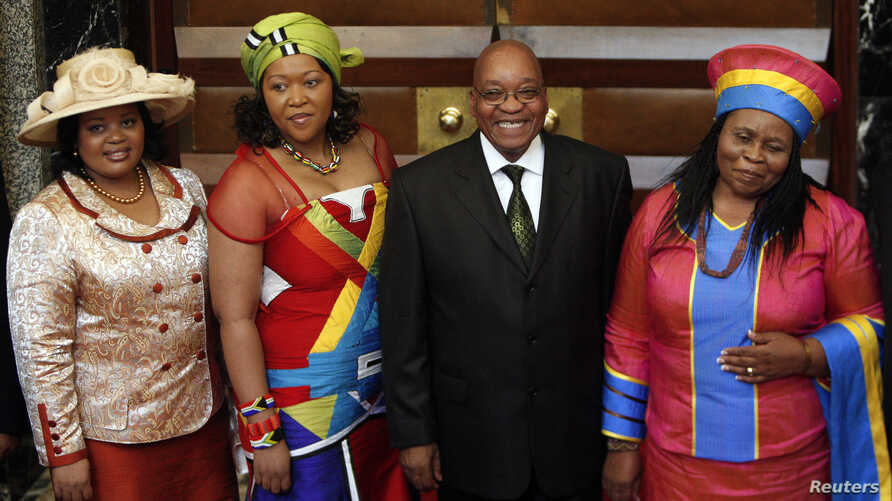 South African President Jacob Zuma poses for photographs with three of his wives  in Cape Town, June 3, 2009.