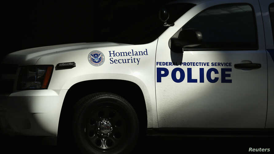 FILE - A Homeland Security vehicle is parked outside a federal government building in San Diego, California, September 24, 2013.