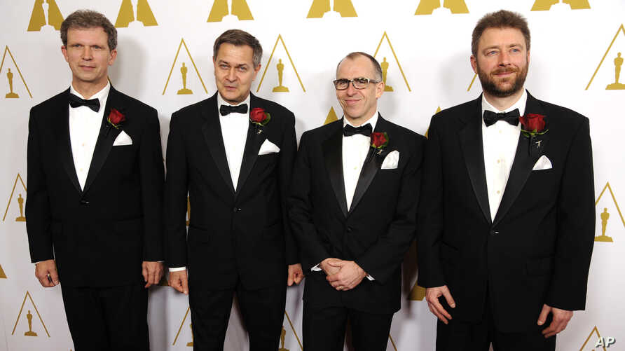 Left to right, Jan Sperling, Emmanuel Prevenaire, Etienne Brandt and Tony Postiau, developers of the Flying-Cam SARAH 3.0 system and recipients of a Scientific and Engineering Award, pose together at the Academy of Motion Picture Arts and Sciences' a