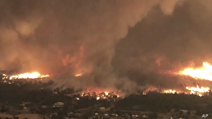 This July 26, 2018, image from video released by Cal Fire shows a fire tornado over Lake Keswick Estates near Redding, Calif. In the history of California wildfires there has never been anything like it: A churning tornado filled with fire, the size ...