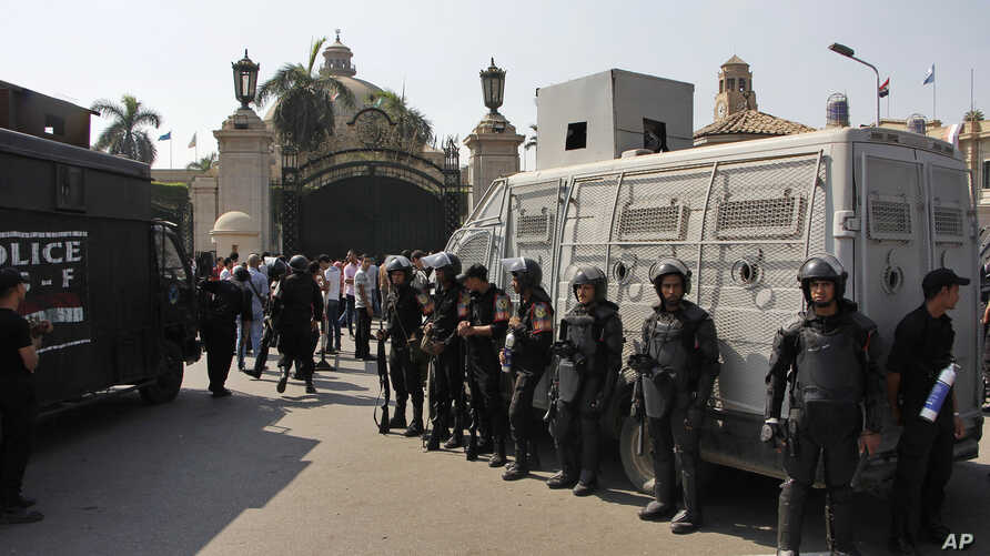 FILE - Egyptian security forces stand guard at Cairo University, Oct. 12, 2014.