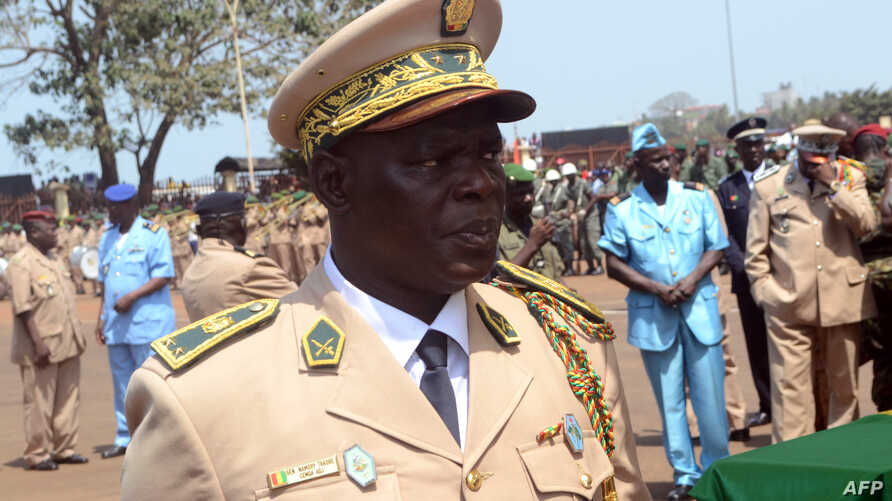 Guinea's Brigadier General Namory Traore takes part in a funeral ceremony in Conakry, Guinea, Feb. 13, 2013.