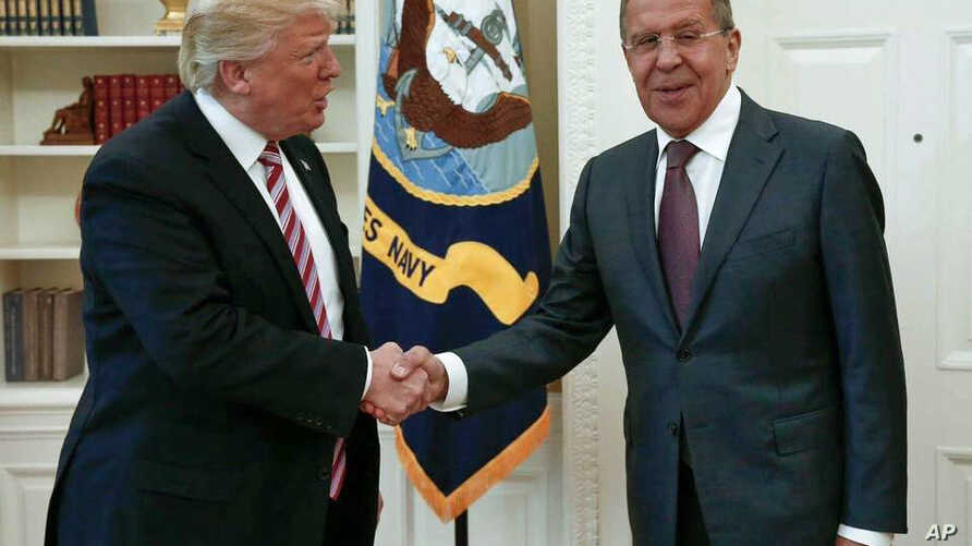 U.S. President Donald Trump shakes hands with Russian Foreign Minister Sergey Lavrov in the White House in Washington, May 10, 2017. (Russian Foreign Ministry photo via AP)
