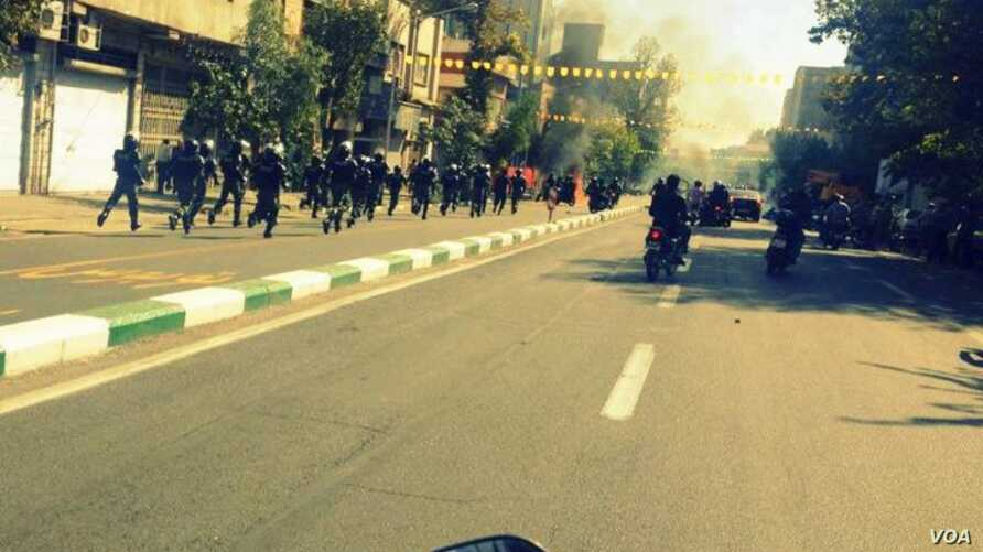 A user generated photo appears to show riot police following protesters down Saadi Street in Tehran. Via Saeed Valadbaygi, via TwitPic