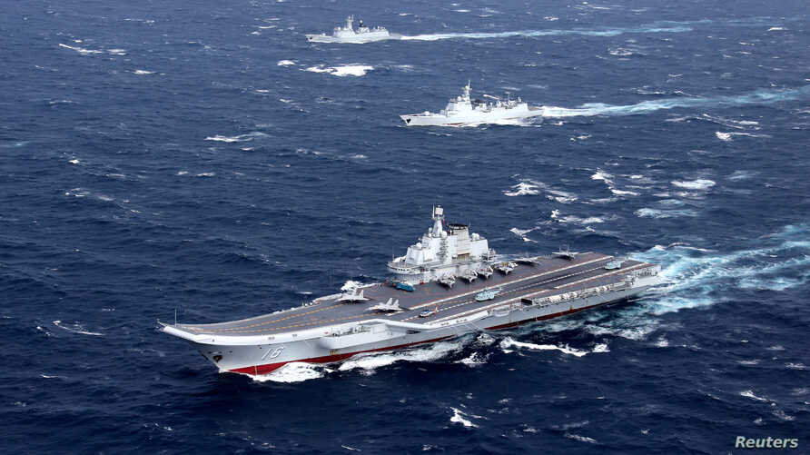 FILE - China's Liaoning aircraft carrier with accompanying fleet conducts a drill in an area of South China Sea, in this photo taken December 2016.