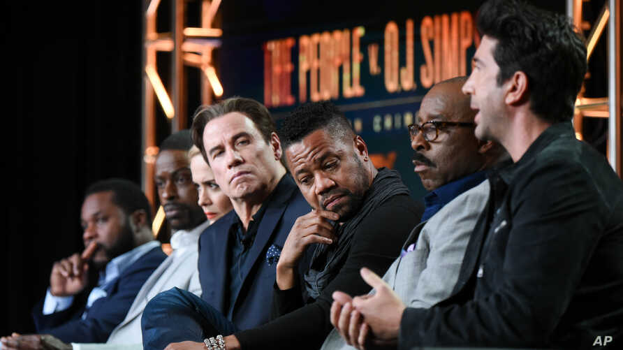 "FILE - Actors Malcolm-Jamal Warner, from left, Sterling K. Brown, Sarah Paulson, John Travolta, Cuba Gooding Jr., Courtney B. Vance and David Schwinner participate in ""The People v. O.J. Simpson"" panel, Jan. 16, 2016."