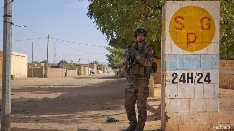 A French soldier secures an area next to an abandoned jihadist bomb factory in Gao, Mali, February 13, 2013.