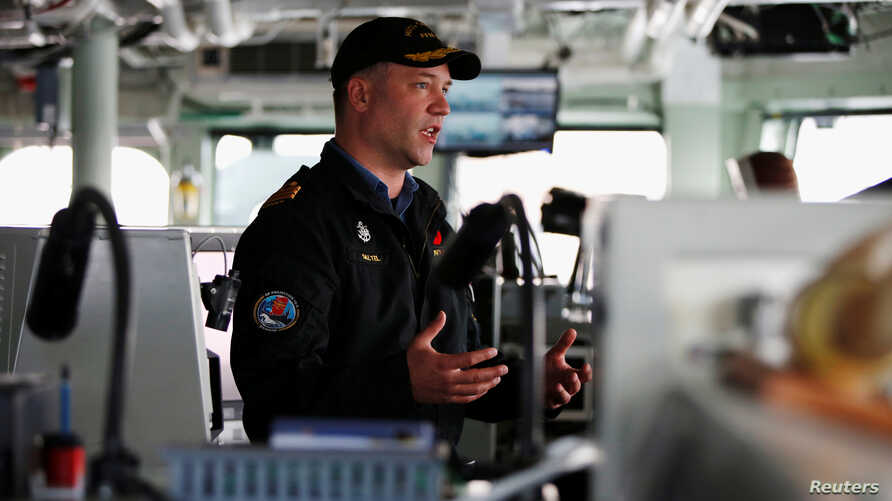 Commander Blair Saltel, the captain of the Royal Canadian Navy's Halifax-class frigate HMCS Calgary, speaks during an interview with Reuters at the U.S. naval base in Yokosuka, Japan, Nov. 7, 2018.