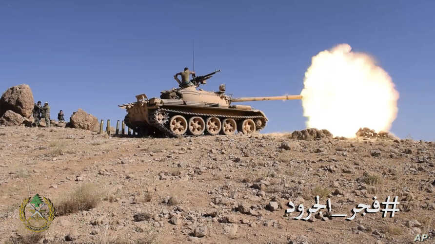 This frame grab from video provided by the Lebanese Army official website, a Lebanese army tank fires during a battle against Islamic State militants, on the outskirts of Ras Baalbek, northeast Lebanon, Aug. 20, 2017.