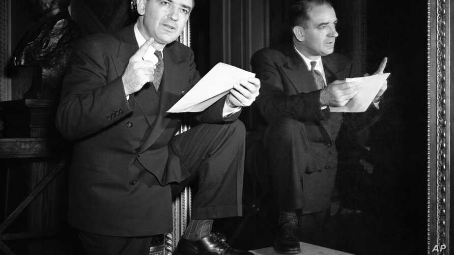 """Sen. Joseph McCarthy (R-Wisc.) poses in Washington, March 23, 1950 after he accused the president of endangering the nation's security by what he called the president's """"arrogant refusal"""" to release loyalty files of State department employees accused"""