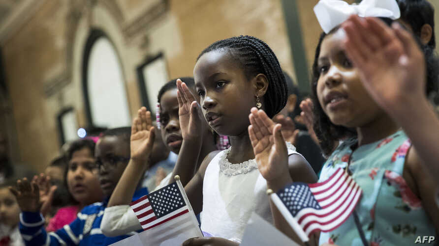 Children take the Oath of Allegiance as they become U.S. citizens during a citizenship ceremony at The Bronx Zoo, May 5, 2017, in The Bronx borough of New York City.