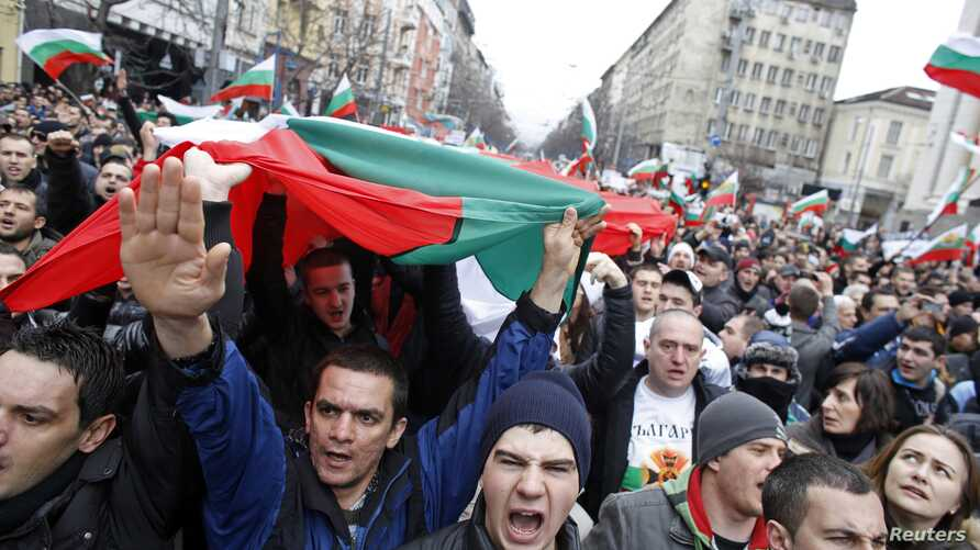 Thousands of demonstrators shout slogans protesting high utility bills and energy-sector monopolies, Sofia, Bulgaria, Feb. 24, 2013.