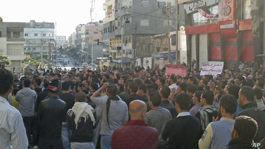 Protesters gather during a demonstration in the Syrian port city of Banias, as forces deployed around the small coastal city for a possible attack, a rights campaigner in contact with Banias said, April 26, 2011