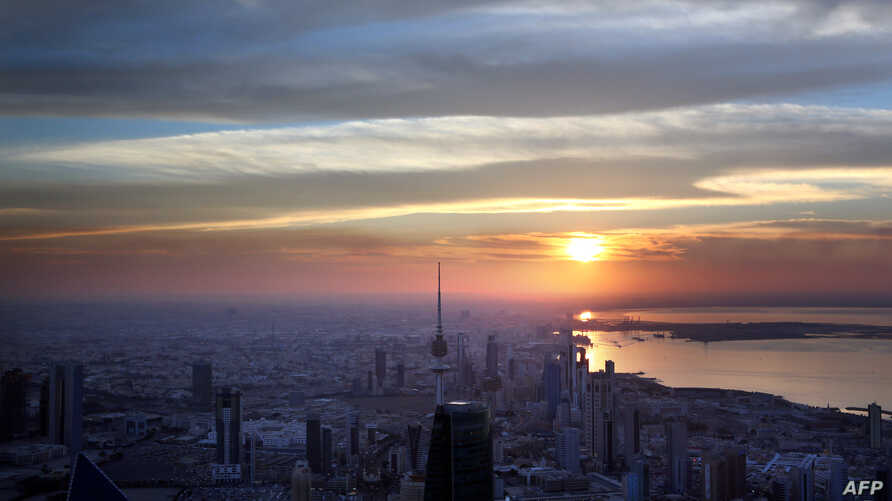 A picture taken on Dec. 19, 2014 from the top of al-Hamra Tower shows a view of Kuwait City at sunset.