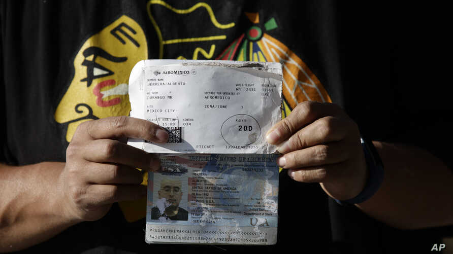 Alberto Herrera, 35, of Chicago shows his boarding pass and water-damaged passport a day after surviving the crash of Aeromexico flight 2431 just after takeoff, in Durango, capital of Durango state, Mexico, Aug. 1, 2018.