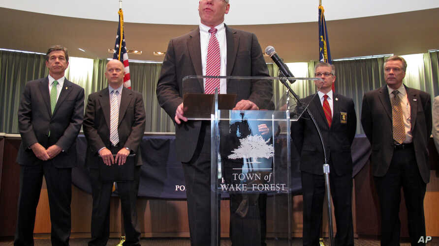 """John Strong, FBI special agent in charge of North Carolina, addresses a press conference at the Wake Forest Town Hall,  April 10, 2014. On Monday, Nov, 29, 2016, Strong said: """"Justin Sullivan planned to kill hundreds of innocent people. He pledged hi"""