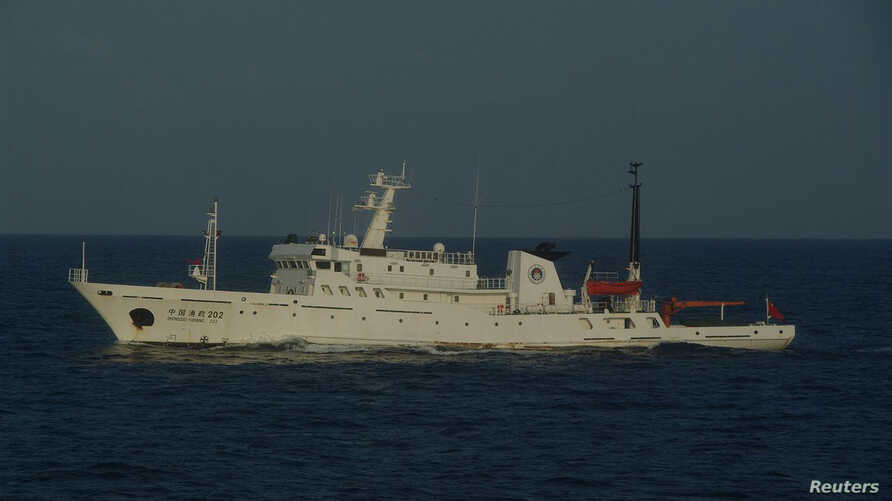 A Chinese marine surveillance ship cruises in waters about 28 km (17 miles) northwest of one of the disputed islands called Senkaku in Japan and Diaoyu in China, in the East China Sea, in this handout photo released by Japan Coast Guard's 11th Region