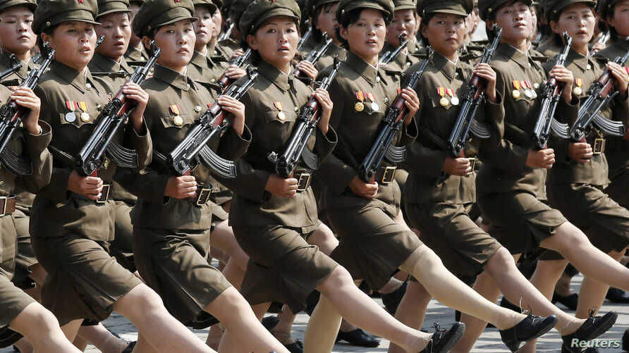 North Korea's Worker-Peasant Red Guard members attend a parade marking the 1948 establishment of North Korea, in Pyongyang in this photo taken by Kyodo, Sept. 9, 2013. (REUTERS/Kyodo)