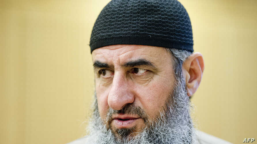 FILE - Picture taken on August 14, 2015 shows Najmuddin Ahmad Faraj also known as Mullah Krekar at court in Oslo. Italian police announced a swoop on a European jihadist network that was allegedly planning to try to spring its leader out of detention