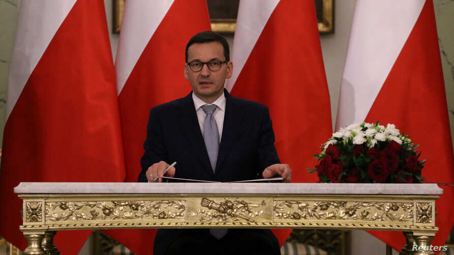 Newly appointed Polish Prime Minister Mateusz Morawiecki reacts after receiving his nomination from President Andrzej Duda during a government swearing-in ceremony in Warsaw, Poland, Dec. 11, 2017.