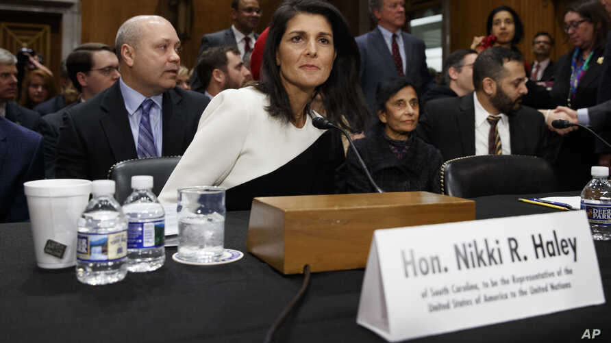 UN Ambassador-designate, South Carolina Gov. Nikki Haley, accompanied by her husband Michael, left, prepares to testify on Capitol Hill in Washington, Wednesday, Jan. 18, 2017, at her confirmation hearing before the Senate Foreign Relations Committee