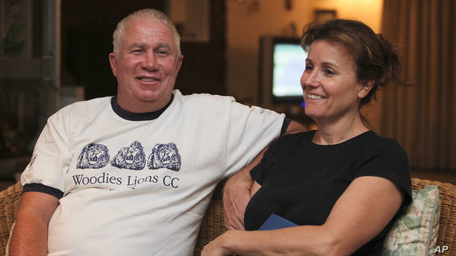 FILE - Roy Bennett, a senior Zimbabwean MDC opposition official, and his wife, Heather, relax at a friends home in Mutare, about 200 kilometers east of Harare, Zimbabwe, following his release from prison. A helicopter crash killed Bennett and his wif