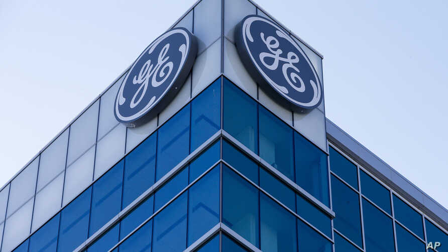 FILE - The General Electric logo is displayed at the top of their Global Operations Center, in the Banks development of downtown Cincinnati.