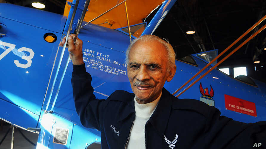Former Tuskegee Airman Herbert Carter, 94, of Tuskegee, Alabama, poses with a PT-17 trainer aircraft in a hangar at Tuskegee Airmen National Historic Site at Moton Field in Tuskegee, Jan. 18, 2012.