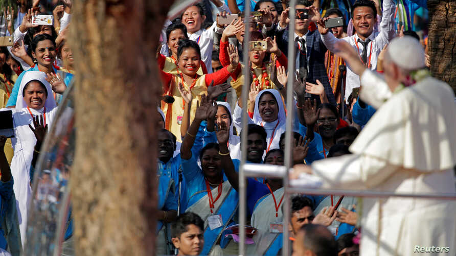Pope Francis greets believers as he arrives for a mass in Dhaka, Bangladesh, Dec. 1, 2017.