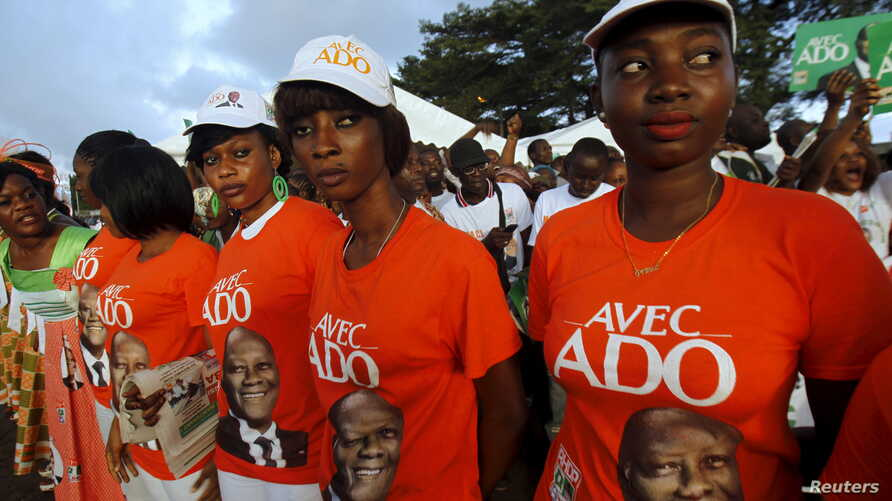 Supporters of Ivory Coast's President Alassane Ouattara and his party, the Rally of the Houphouetists for Democracy and Peace (RHDP), attend a campaign rally at the place inch alla in Abidjan, Oct. 20, 2015.