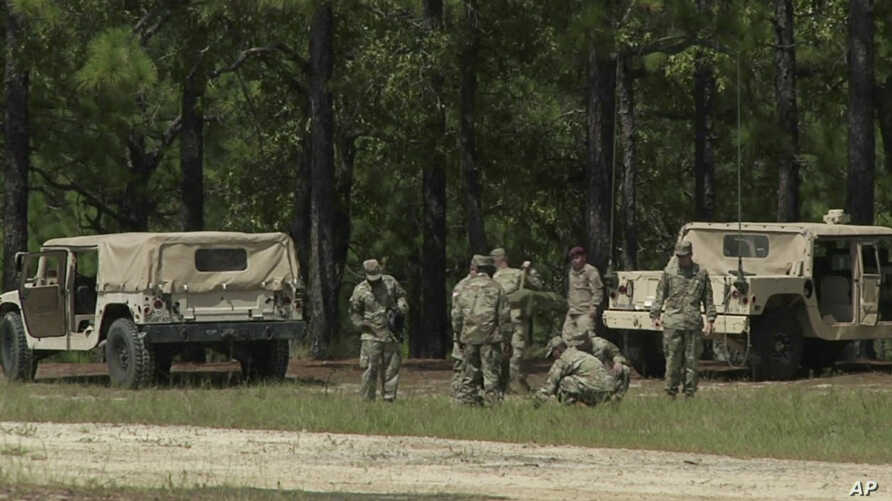 This image made from a video shows soldiers on Fort Bragg, N.C., Sept. 14, 2017. A training exercise involving demolitions turned deadly at the Army's largest base Thursday, killing one soldier and injuring several. Soldiers pictured were not involve